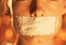 Woman with tape on mouth